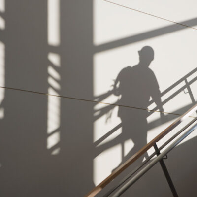 workers-shadow-in-a-stairwell-8PG94E3